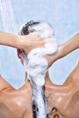 Washing long female hair by shampoo — Stock Photo