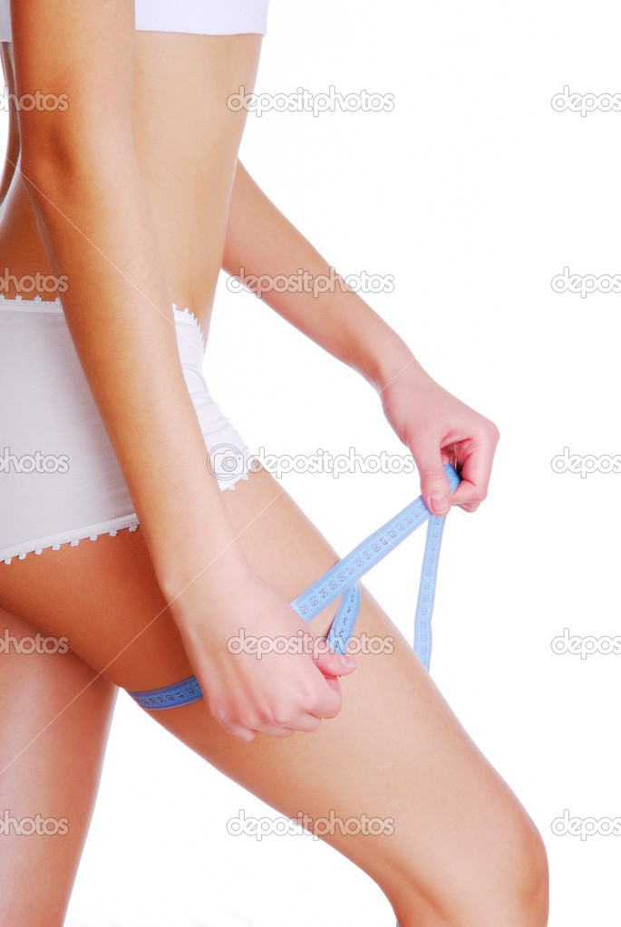 Woman measuring her thigh checking the result of diet  Stock Photo #1537211