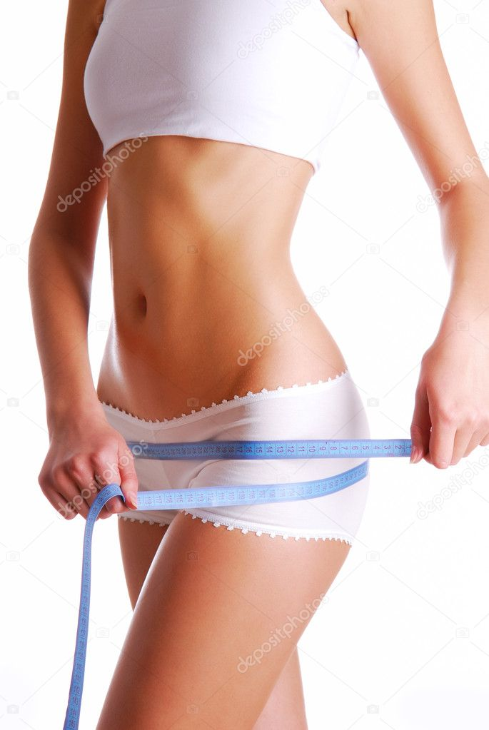 Woman measuring perfect shape of beautiful thigh.   Healthy lifestyles concept  Foto de Stock   #1537371