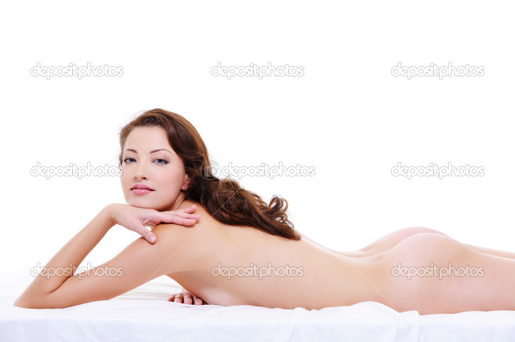 Beauty woman with a sexy naked  body posing  on bed  Stock Photo #1537646