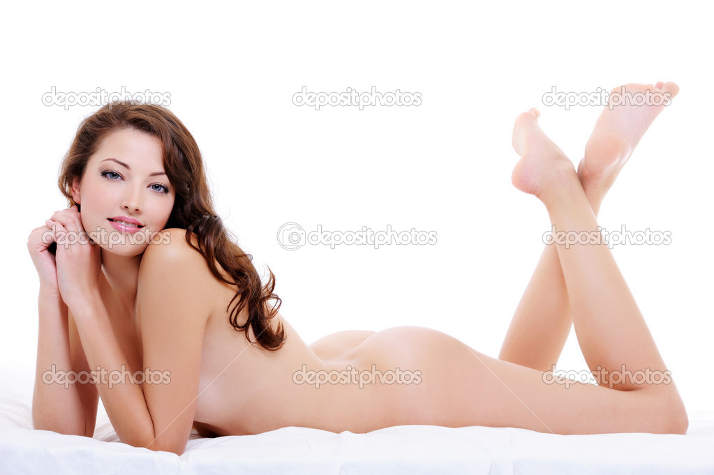 Full-length portrait of a nude flirting woman  lying down on the bed — Stock Photo #1537679