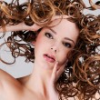 Woman with  long curly hairs - Stock Photo