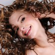 Stock Photo: Womwith long curly hairs