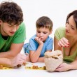 Stock Photo: Parents playing with little son
