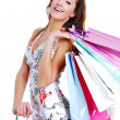 Happy cute young woman shopping - Stock Photo