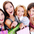Laughing girls with shopping bags — 图库照片