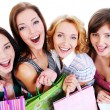 Laughing girls with shopping bags — Stok fotoğraf