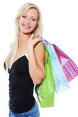 Blonde woman with purchases — Stock Photo