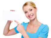 Woman pointing on blank white card — Stock Photo