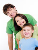 Happy faces of an young family — Stock Photo