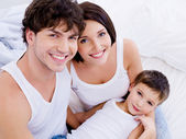 Happy mother and father with son — Stock Photo