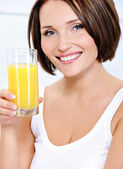 Smiling woman with glass of juice — Stock Photo