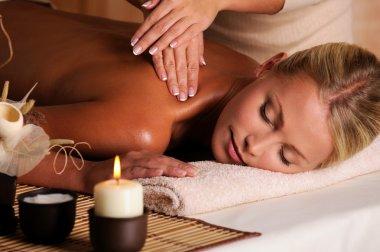 Masseur doing massaging of female