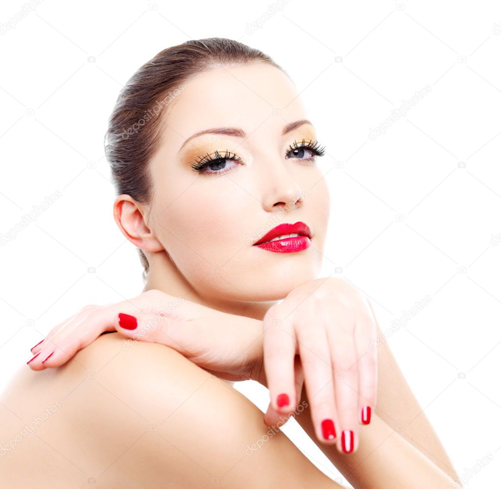 Close-up face of a sensuality  woman with red bright manicure and lips — Stock Photo #1543818
