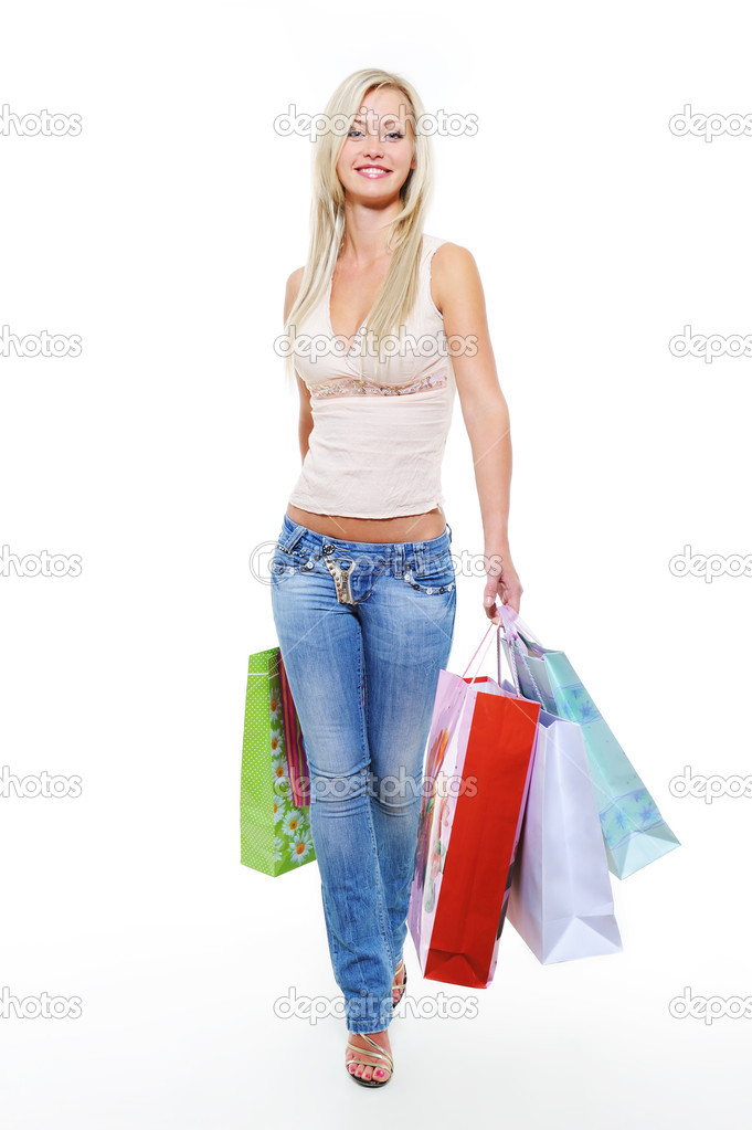 Full-length portrait of a happy walking girl with shopping bags — Stock Photo #1545393