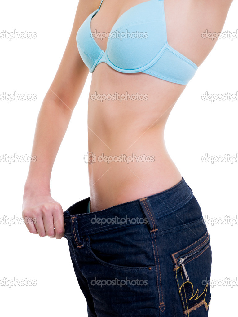 Side view of female became skinny and wearing old jeans - Unrecognizable  person  Stock Photo #1547345
