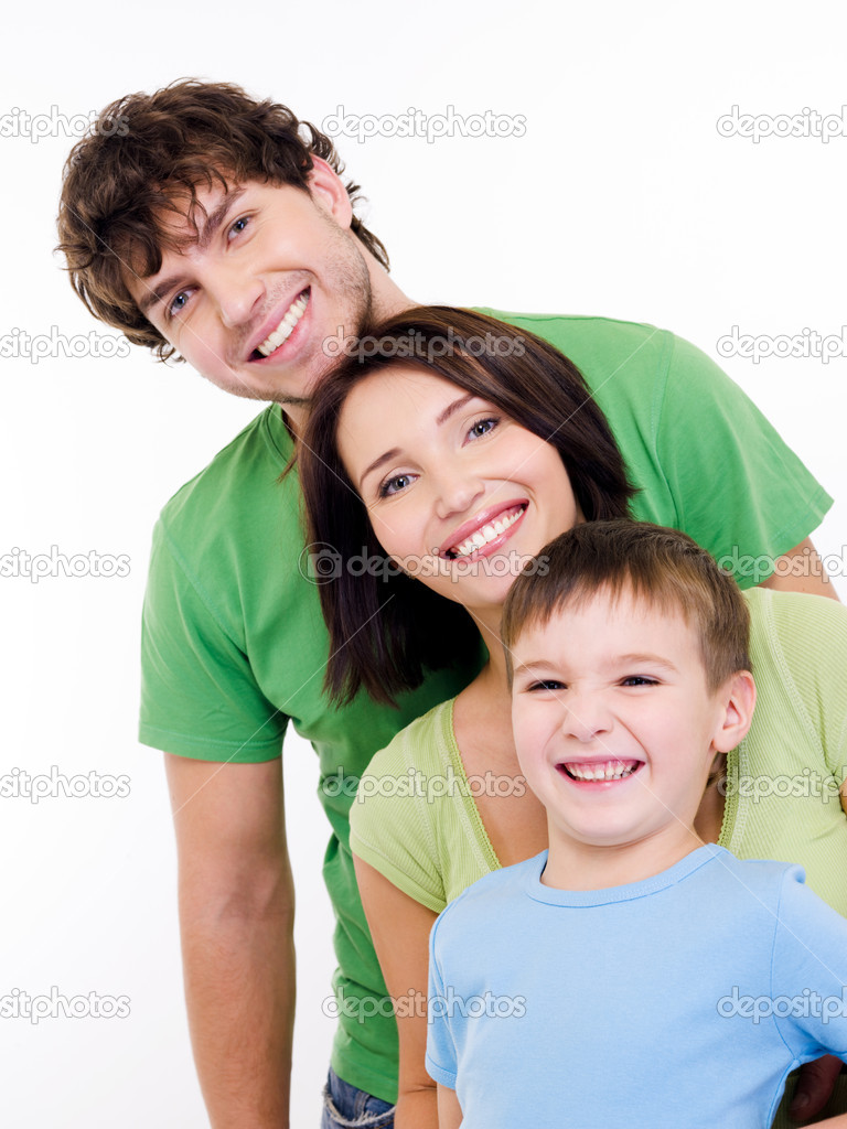 Group portrait of the young happy smiling family looking at camera — Stock Photo #1547621