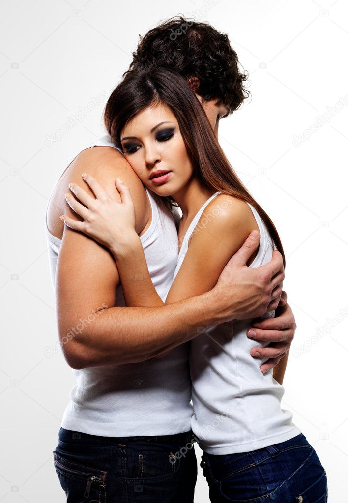 Two young beautiful embracing lovers - posing at studio  Stock Photo #1547889
