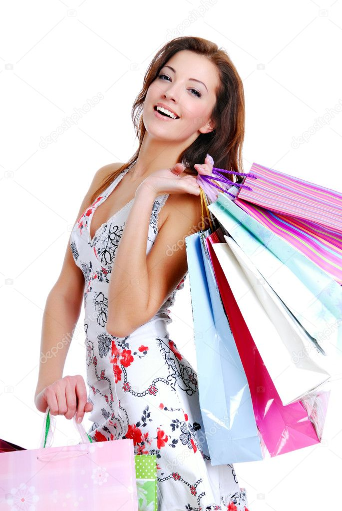 Happy cute young woman shopping with color bags - isolated on white — Foto de Stock   #1548143