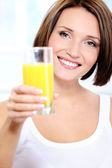 Woman with glass of orange juice — Stock Photo