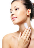 Female applying moisturizer cream — Stock Photo