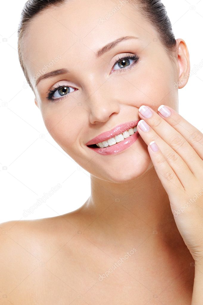 Portrait of Pretty smiling young woman with hand at lips over white