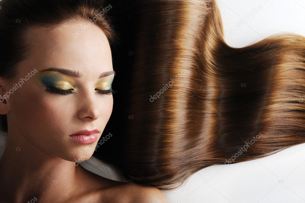 Beautiful caucasian female face with long luxuriant hair - closed eyes — Stock Photo #1550231