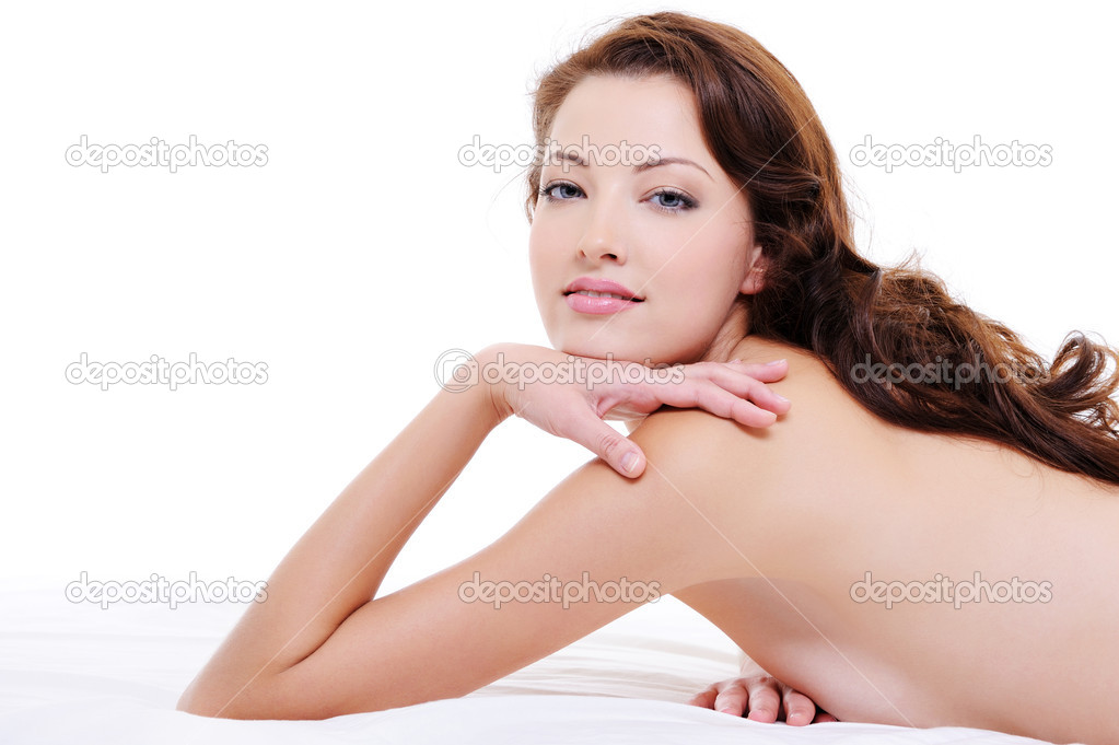 Portrait of a  pretty red hair woman with nude body lying on white bed  Stock Photo #1553100