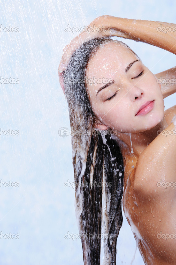 Pretty beautiful woman washing her hair in a shower - close-up portrait — Stock Photo #1553181