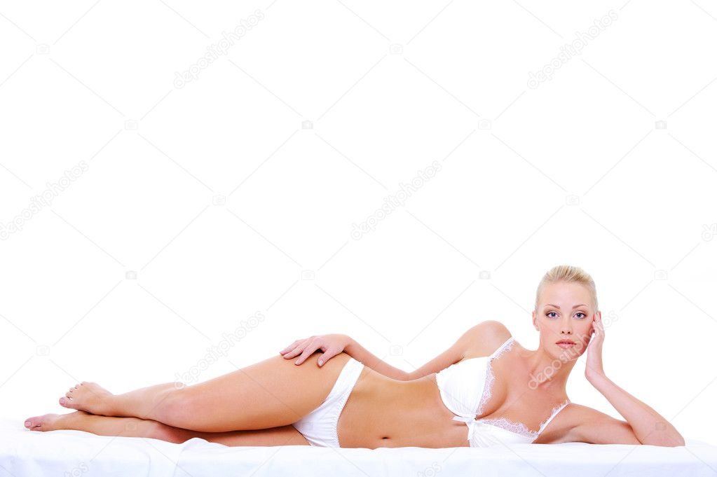 Beautiful caucasian blonde woman with perfect sexy body lying down on the bed — Foto de Stock   #1553291