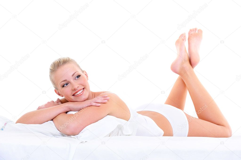 Happy cute beautiful smiling woman lying on the soft bed  Stock Photo #1553358