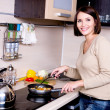 Woman is on the kitchen prepares to eat - Stock Photo
