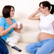 Pregnant  communicates with girlfriend - Stockfoto