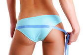Female buttocks with a measurement tape — Stock Photo