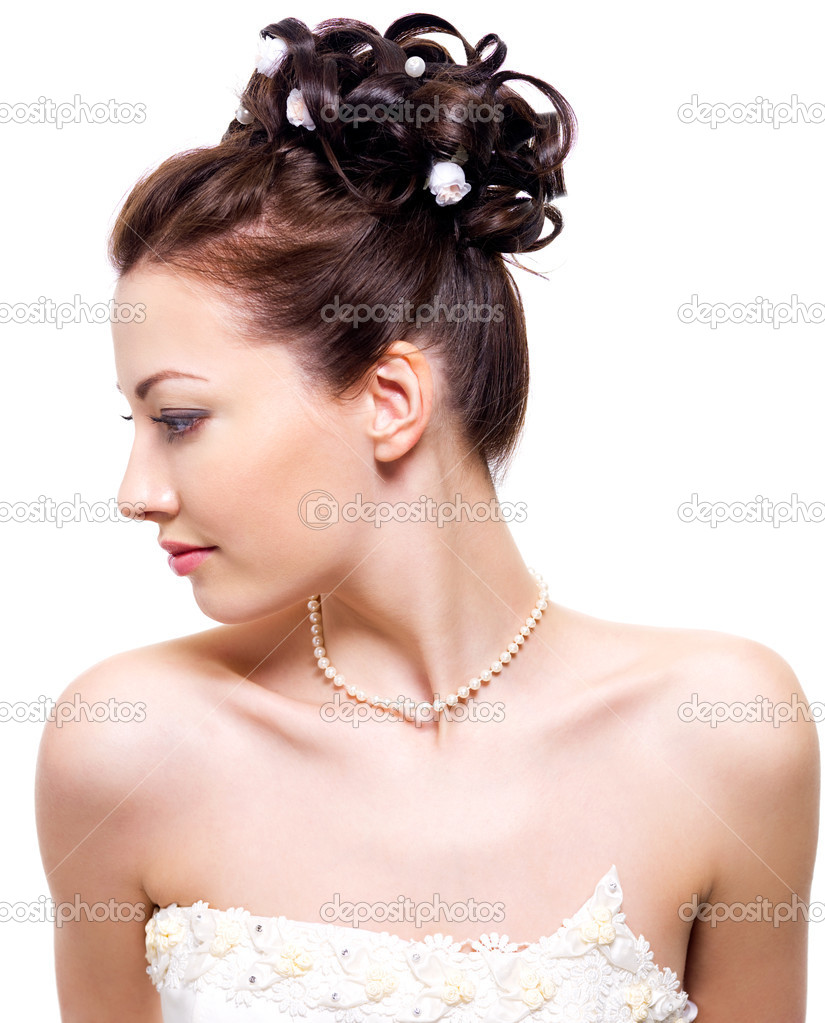 Profile portrait of a beautiful bride with wedding hairstyle - on white background — Stock Photo #2510092