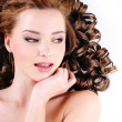 Woman with  long ringlets hairs — Stock Photo