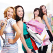 Foto Stock: Happy fun women with purchases