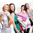 Happy fun women with purchases — Stock Photo