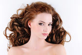 Attractive young woman with curly hairs — Stock Photo