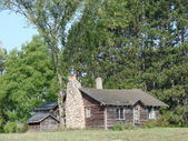 Rustic log cabin — Stock Photo