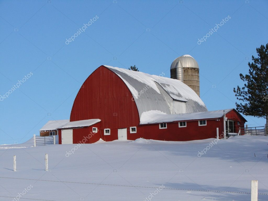 Red barn with tin roof,silo,attached sheds on snow covered hill. — Stock Photo #1566112