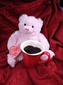 Pink bear with heart cookie and mug — Stock Photo