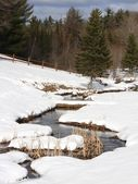 Meandering stream in snow — Stock Photo