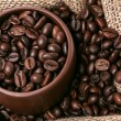 Coffee in brown cup in sack from above - Stock Photo