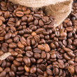 Coffee beans poured out of a sack down — Stock Photo