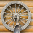 Wooden wheel and spoon - Stock Photo
