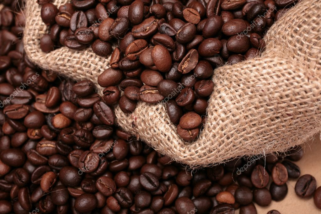 Coffee on both sidesof a sack cloth — Stock Photo #1508383