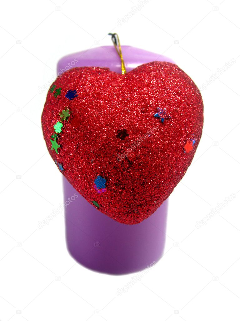 Violet candle with a red heart with a filigree attached to the Valentine's Day — Stock Photo #1419767