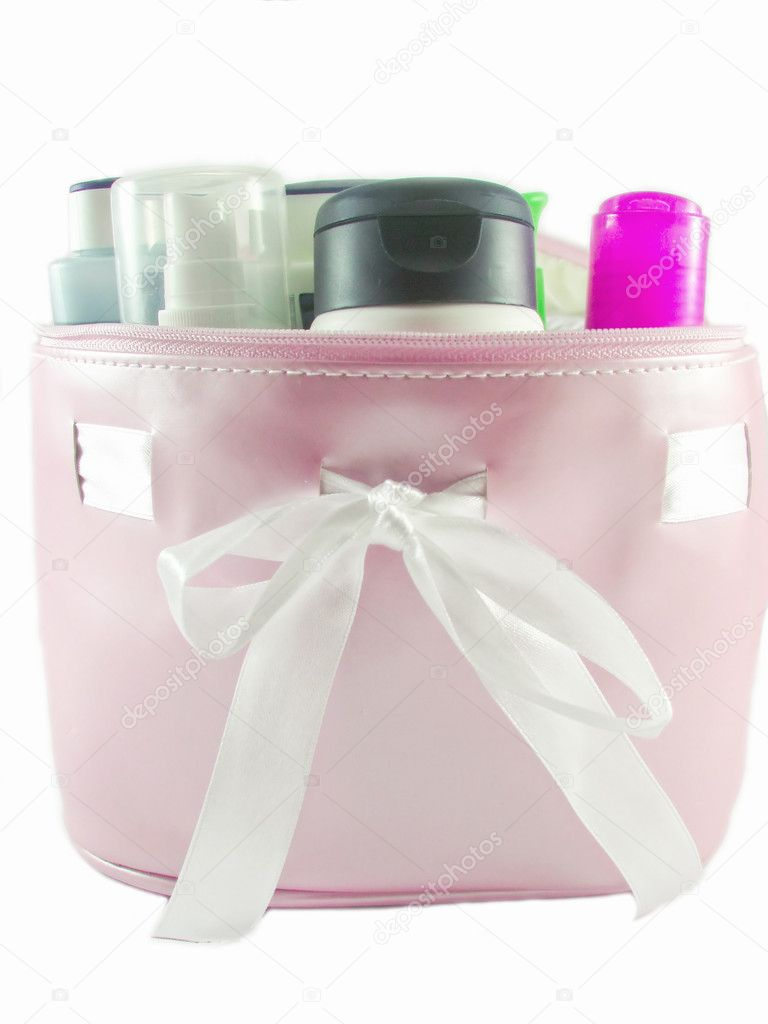 Open pink bag with cosmetics — Stock Photo #1420725