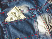Jeans and dollars — Stock Photo